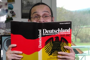 A photo of Andrew reading up on German history. (47kB)